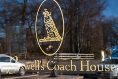 Boswell's Coach House, logo on the door.